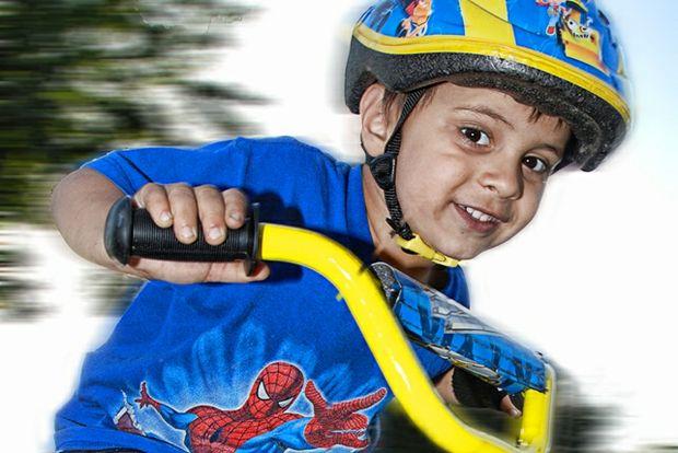 Boy riding new bike with helmet