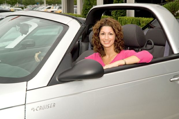 woman smiling in convertible