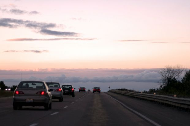 dusk on highway rearview brake lights