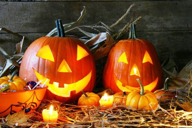 halloween lit pumpkins and candy