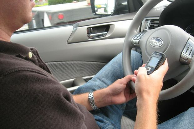 texting while driving by Jason Weaver