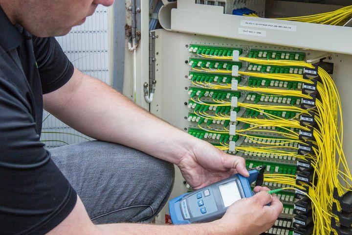 Technician installs fiber