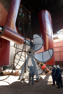 Shipbuilders at Northrop Grumman Shipbuilding completed a significant milestone on the Nimitz-class aircraft carrier USS Theodore Roosevelt (CVN 71) by completing the installation of the ship's propulsion shafting and propellers on Dec. 5.  Photo by Jo...