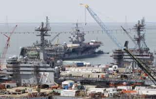 USS Enterprise (CVN 65) passes George H.W. Bush (CVN 77) and USS Carl Vinson (CVN 70)