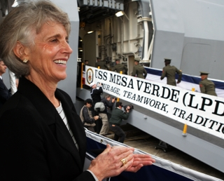 Man's Her Ship -- Linda Campbell, the ship's sponsor, joins 4,000 guests in applauding the sailors and Marines who boarded her ship, Mesa Verde (LPD 19)