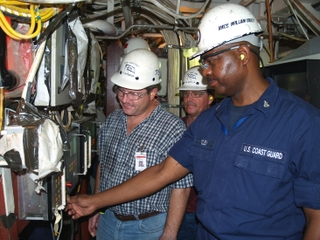 Coast Guard Senior Chief William Bodley (right) pushes the button to start the first diesel engine on board Bertholf.