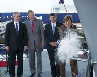(Left to right) President George W. Bush, Former President George H.W. Bush, and Mike Petters, president, Northrop Grumman Newport News, look on as Ships' Sponsor Doro Bush Koch christens CVN 77, the aircraft carrier George H.W. Bush.