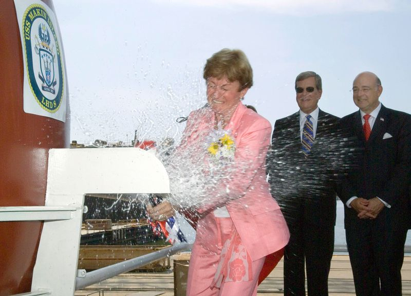 Mrs. Silke B. Hagee, wife of U.S. Marine Corps Commandant Gen. Michael W. Hagee, and sponsor of Makin Island (LHD 8), smashes a champagne bottle against the bow of the Wasp-class amphibious assault ship
