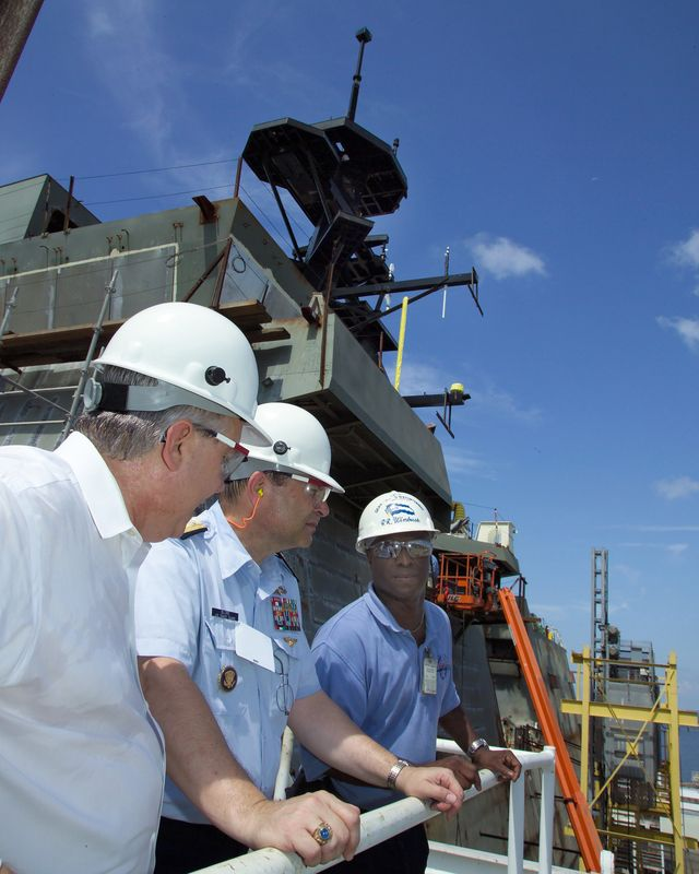 U.S. Coast Guard Rear Adm. Gary T. Blore, center, program executive officer for the Integrated Deepwater System, toured Bertholf (WMSL 750), the first National Security Cutter being erected at Northrop Grumman's facility in Pascagoula, Miss.