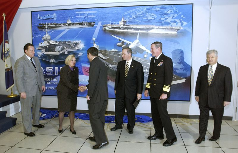Northrop Grumman Newport News President Mike Petters (third from left) shakes hands with Rep. Thelma Drake (R-Va.) after unveiling a mural dedicating the Aviation Ship Integration Center (ASIC)