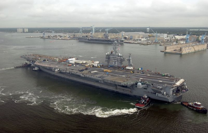 Tugboats moved the USS George Washington (CVN 73)