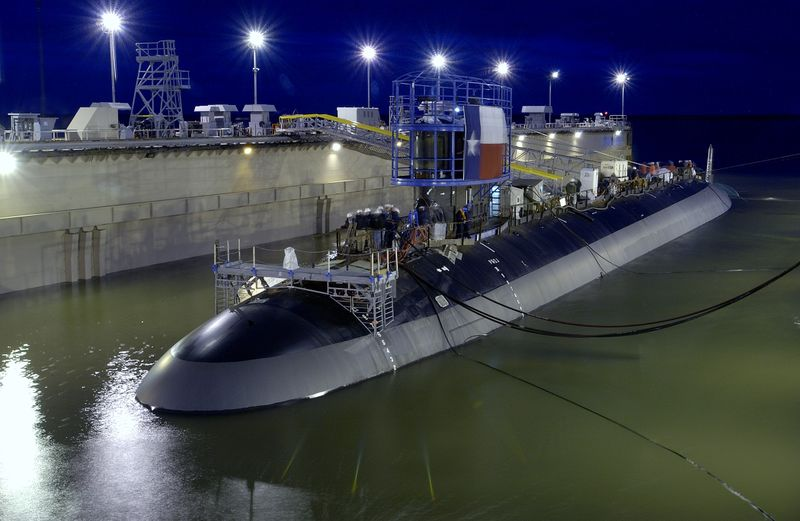The floating dry dock holding Texas slowly fills with water before the submarine is launched into the James River on April 9.