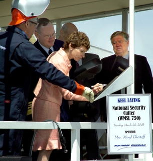 "(l-r) Veteran Northrop Grumman Ship Systems welder L.W. ""Billy"" Ross helps Meryl Chertoff, sponsor of the first National Security Cutter (WMSL 750), sign her initials to the ceremonial plaque during Tuesday's keel laying ceremony in Pascagoula, Miss."