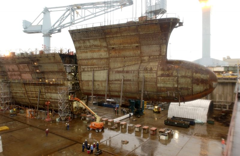 Northrop Grumman Newport News reached a construction milestone by lowering the final keel section of the George H. W. Bush (CVN 77)
