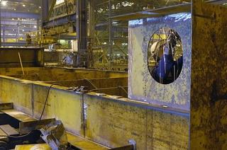 Northrop Grumman Newport News employee Josh Cantrell welds the keel section of the USS Monitor replica