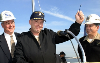 Cmdr. Robert M. Byron, USN, the Commissioning Commanding Officer for USS Pinckney (DDG 91), commemorating the delivery of DDG 91