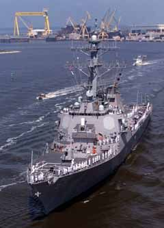 The USS Cole is shown here as it departs Pascagoula, Miss., Friday for its homeport in Norfolk, Va.