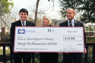 Edenzon Presents Check to Special Olympics Mississippi
