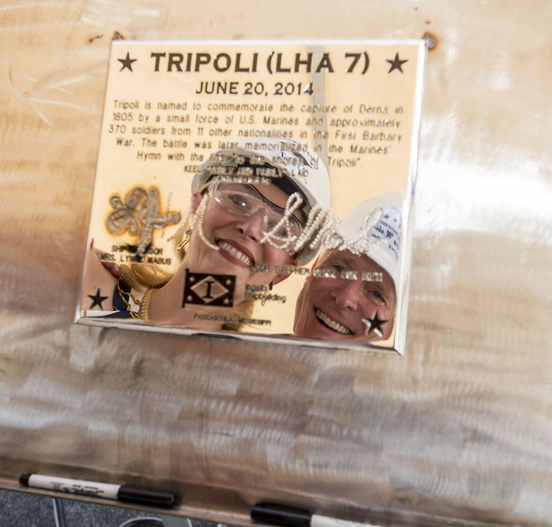 Lynne and Ray Mabus Reflected in Tripoli's Keel Plate