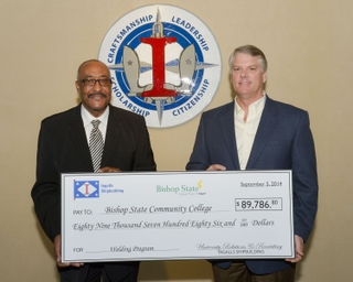 Brian Cuccias Presents Check to Bishop State Community College