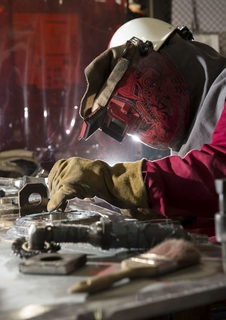 Welder Works on Washington