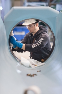 Todd Ashley Works on a Torpedo Tube