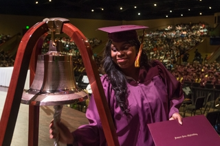Tiffani Brown Powell Rings the Apprentice School Bell