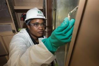 Ashley Adkinson Touches Up a Storage Locker