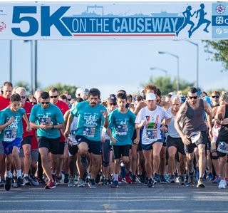 "Photo Release--Ingalls' Eighth Annual ""5K on the Causeway"" Raises $50,000 for Special Olympics Mississippi"