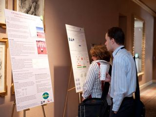 Attendees study one of over 90 research posters at GTC 2009.