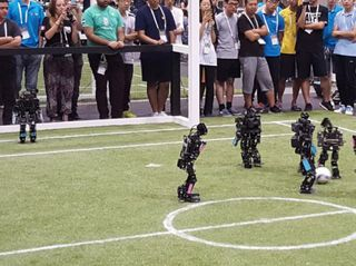 Researchers and Robots Swarm Japan's RoboCup Competition