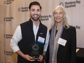 Monterey Bay Aquarium Executive Direcctor presents AssemblyMajority LeaderIan Calderonwith anOcean Champion Award at a Sacramento reception during Ocean Day California on March 19, 2019.