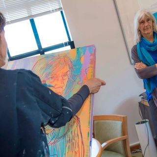 Artist Hope Gangloff sketches Monterey Bay Aquarium Executive Director Julie Packard during a portrait sitting.