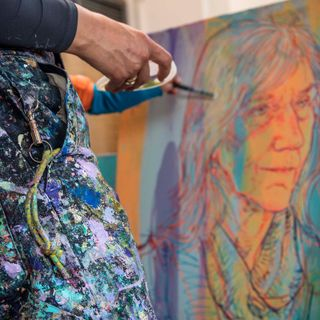 Artist Hope Gangloff works on a study for a portrait of Julie Packard.