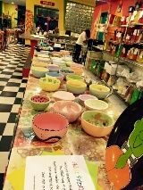 Associated Bank colleagues fill bowls at Empty Bowls event