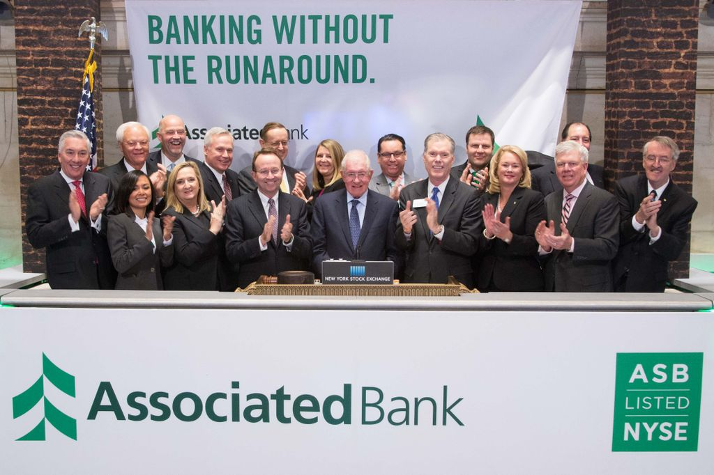 Associated Bank knocks down notion of banking barriers, celebrates transfer to NYSE with The Opening Bell