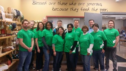Associated Bank Private Client & Institutional Services colleagues volunteer time to pack food for Feed My Starving Children