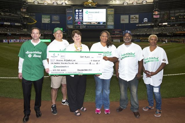 Associated Bank and the Milwaukee Brewers wrap up Hits for Homes program with $100,000 donation to Housing Resources, Inc.