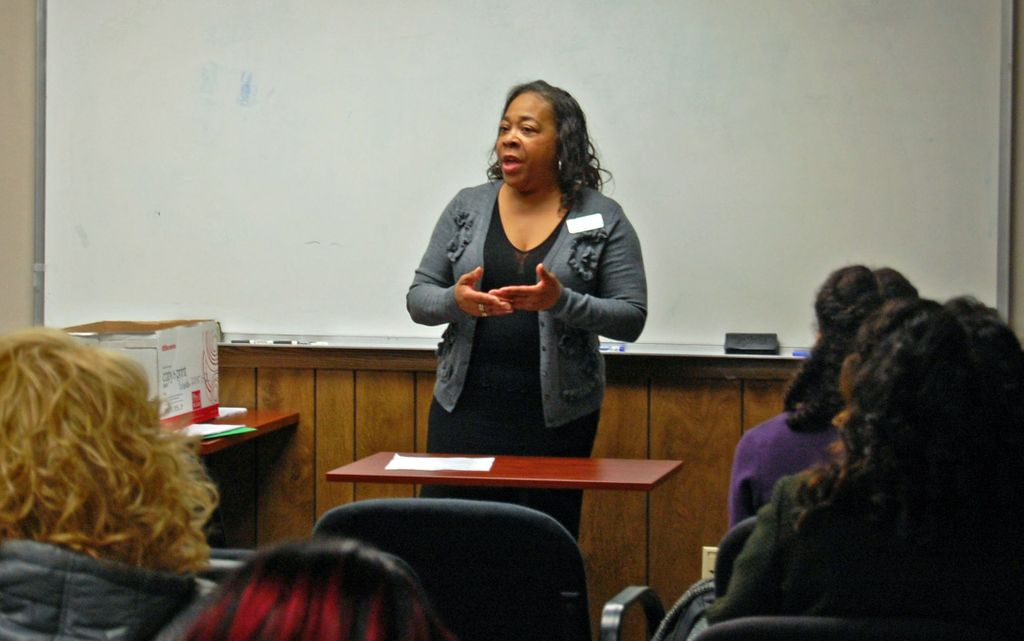 Shiela Roberts, residential loan officer, Associated Bank, speaks to a group of potential homebuyers during a first-time homebuyers workshop at Housing Resources, Inc.