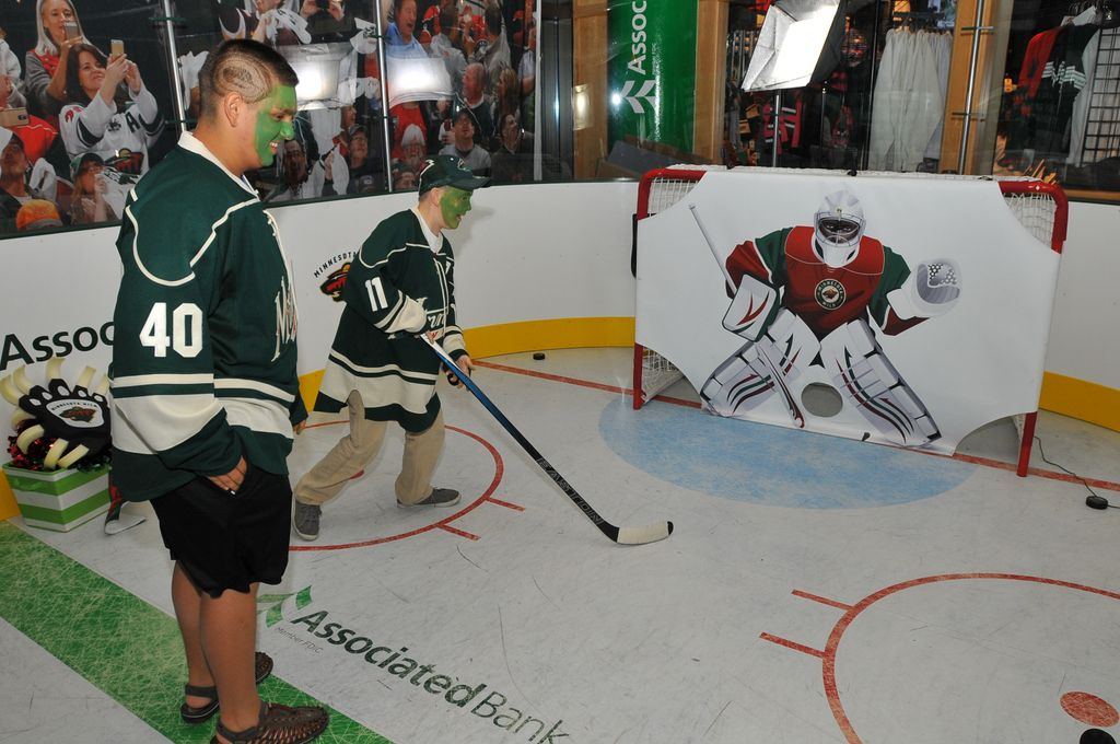 Fans are invited to test their hockey skills at the Associated Bank Power Play Zone at Xcel Energy Center during all Wild home games.