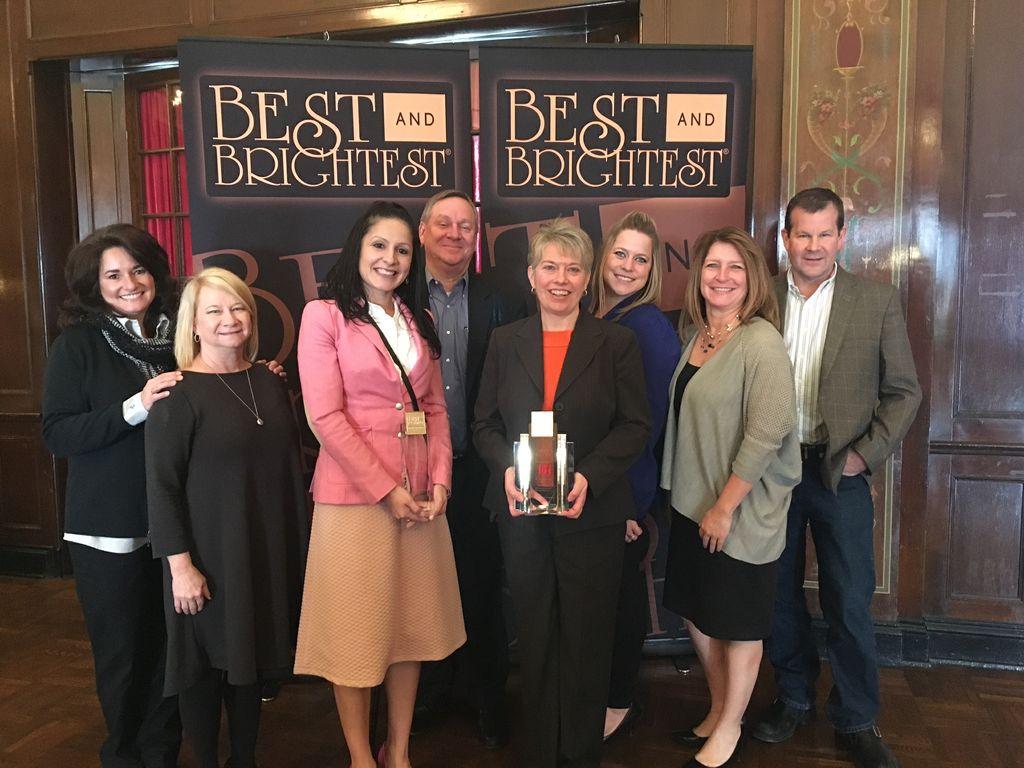 Associated Bank colleagues accepting the award include (left to right): Julie Glynn, Sandi Meka, Elizabeth Strike, Harlan Knuth, Laurie Riedy Timmerman, Ashley Koepke, Marnie Van Matre and John Frye