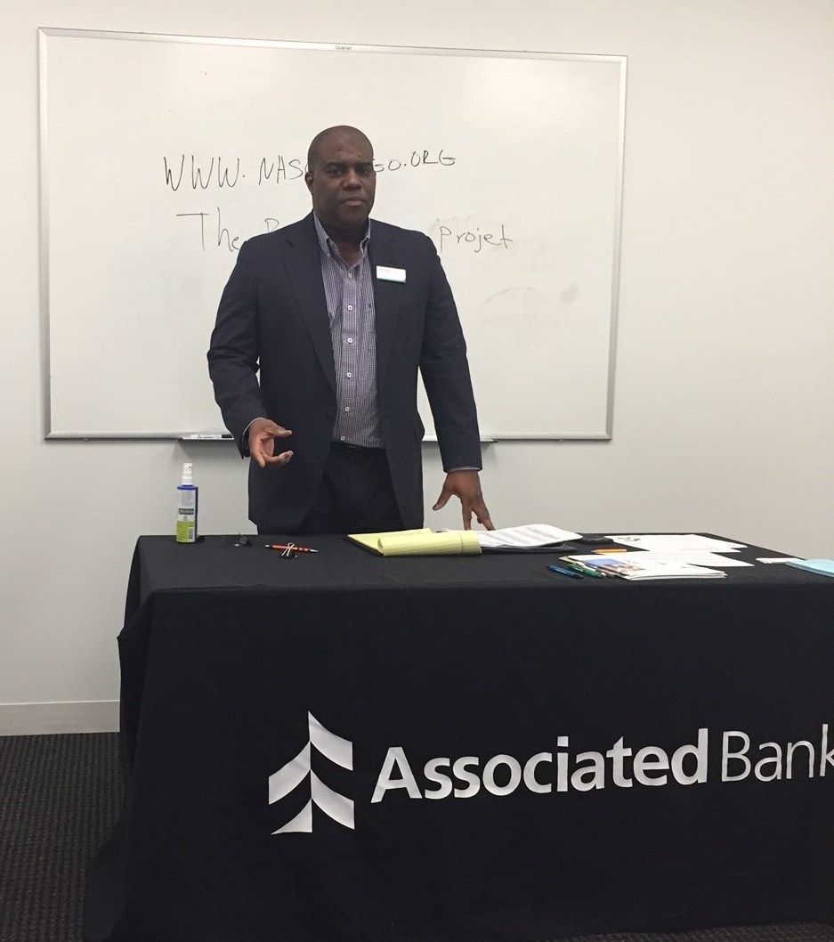 Kevin Greer, CRA residential loan officer, Associated Bank, speaks to first-time homebuyer workshop attendees at the Associated Bank loan office in Rogers Park.