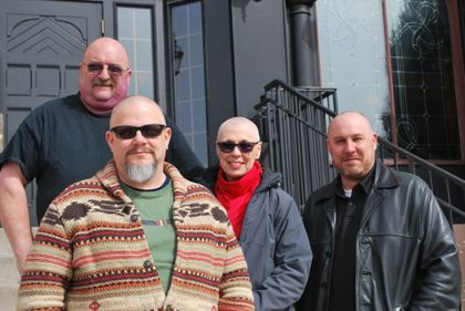 Associated Bank Green Bay bankers go bald for a cause