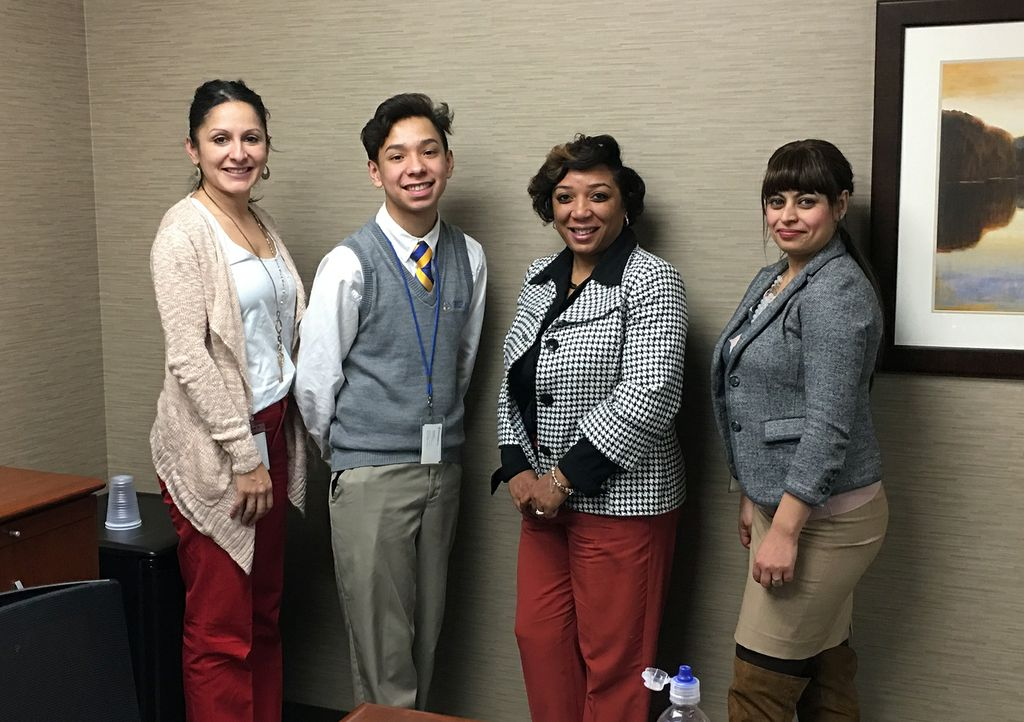 Associated Bank's Elizabeth Strike (left), Clarice Ollins (third from left) and Ranya Baldwin hosted skill-building workshops for Milwaukee-area youth as part of Cristo Rey's Corporate Work Study Program.