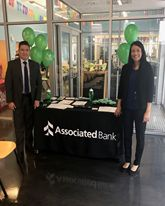 Jaun Carlos Callan (pictured left) and Jeanette Vigil attend the Annual Mortgage Assistance Fair.