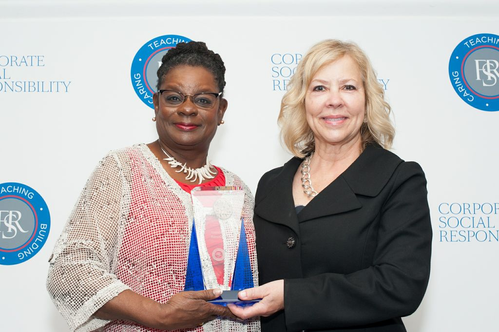 Congresswoman  Gwen Moore (left), pictured with Associated Bank's corporate social responsibility manager Jill Wiess