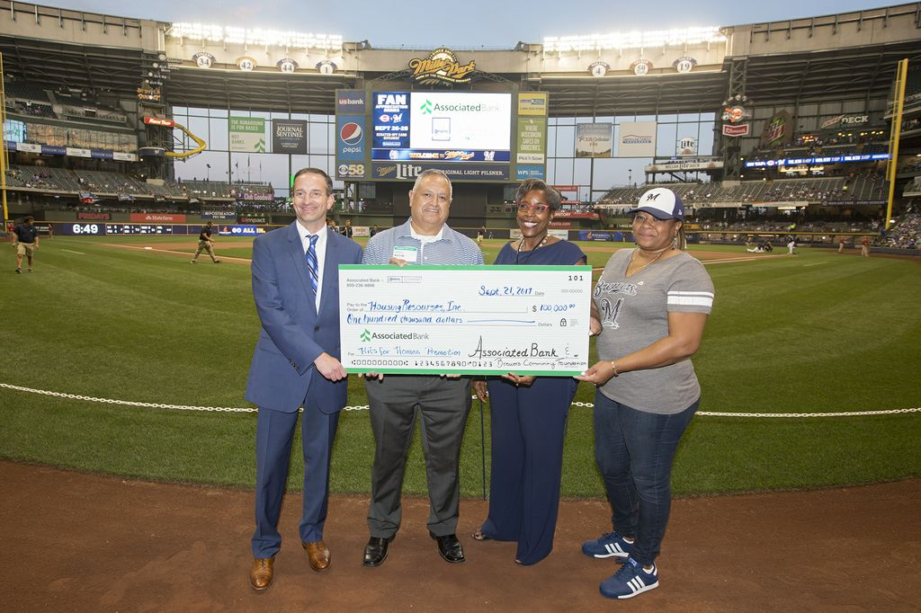 Pictured left to right: Christopher Piotrowski  and  Eduardo Herrera-Mier of Associated Bank and Cecilia Gore of Brewers Community Foundation present a check in the amount of $100,000 to Trena Bond of  Housing Resources, Inc.