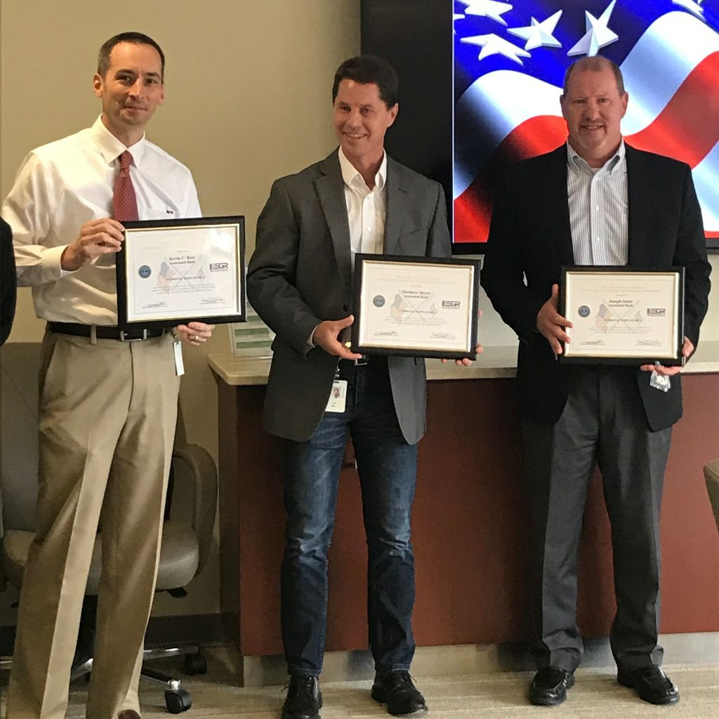 Associated Bank colleagues (from left to right), Kevin Ress, Matt Meyer and Joe Smits, in Green Bay accept a Patriot Award by the ESGR.