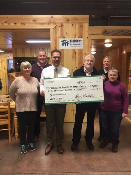 Associated Bank colleagues present a check to Habitat for Humanity of Sawyer County.