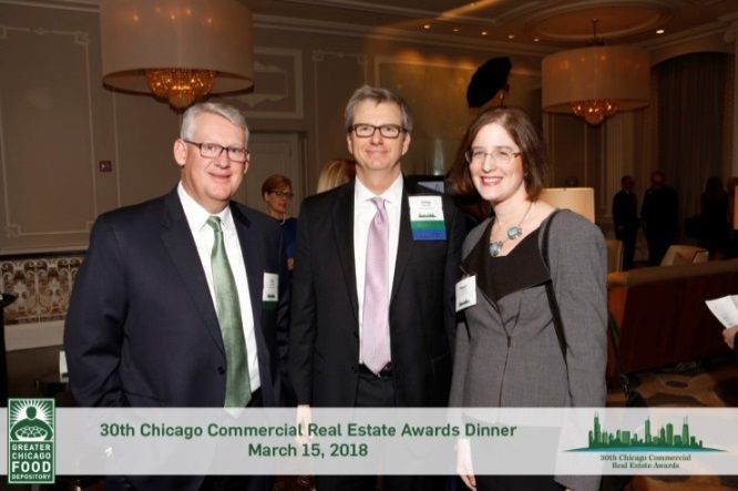 (Left to right) Paul Schmidt and Greg Warsek, Associated Bank; Megan Abraham, The Goldie Initiative at the Chicago Commercial Real Estate Awards Dinner